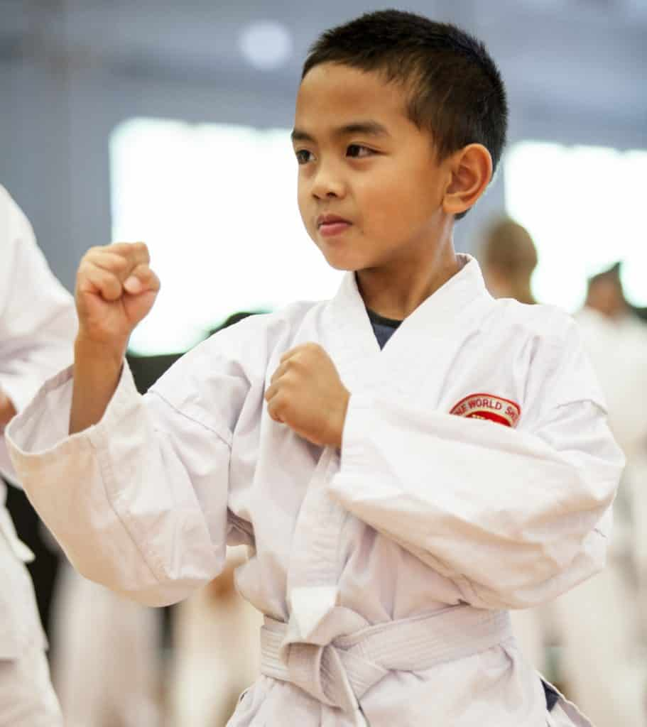 young white belt posing defensively looking away from the camera