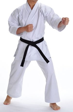 man posing in a white karate gi