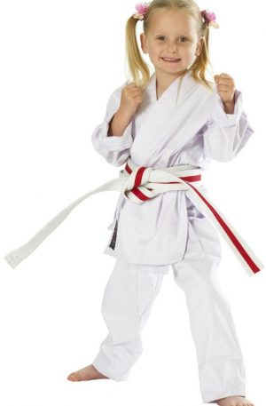 young girl posing in a white karate gi