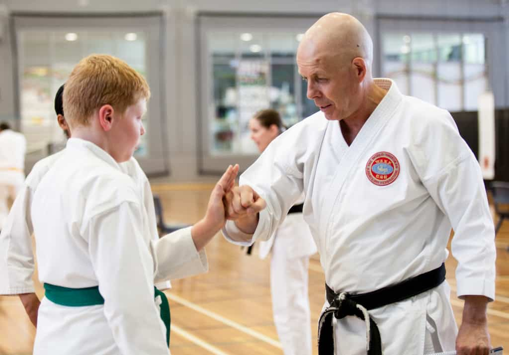 A picture of grant teaching a green belt student