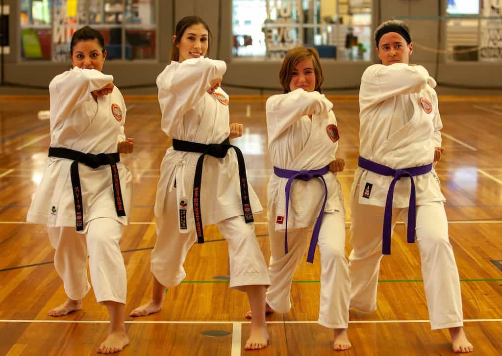 group of mothers and daughters showing their elbow strikes towards the cameras