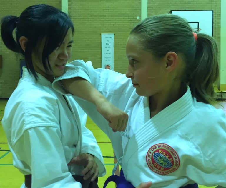 young girls showing control with an elbow strike